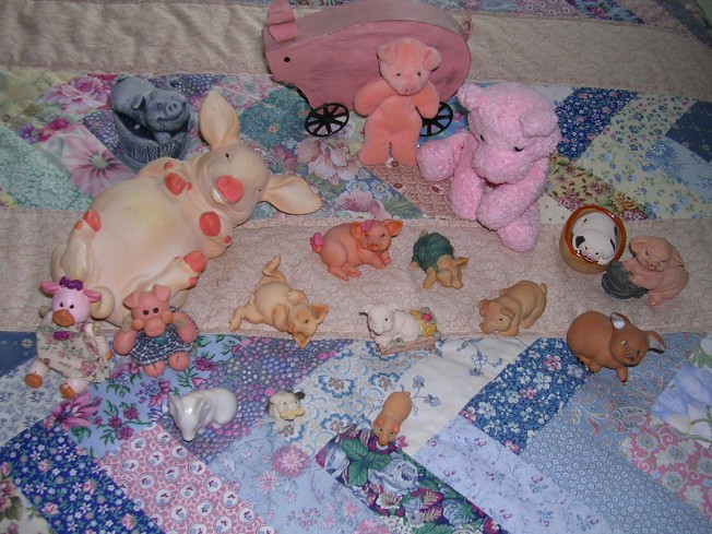 "An ""aerial shot"" of piggy heaven on the guest bed!"