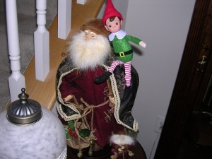 An old-timey Santa with a NEW Elfvis!
