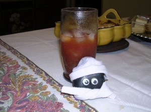 Bashful TRYING to sneak a taste of Mom's bloody mary!