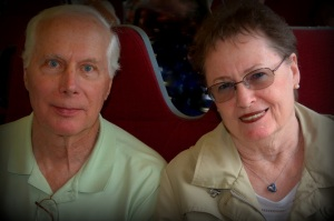 My Mom and Dad with happy faces - they're on the train having a blast!